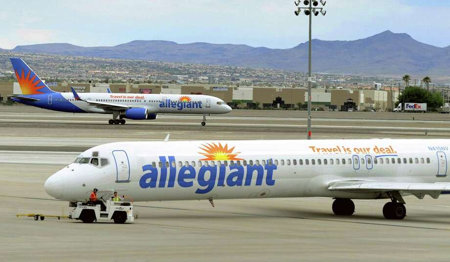 In this May 9, 2013, photo, two Allegiant Air jets taxi at McCarran International Airport in Las Vegas. Shares of Allegiant Airs parent company are tumbling following a 60 Minutes investigation that expressed serious safety concerns about the airline. Photo: David Becker /Associated Press / FR170737 AP