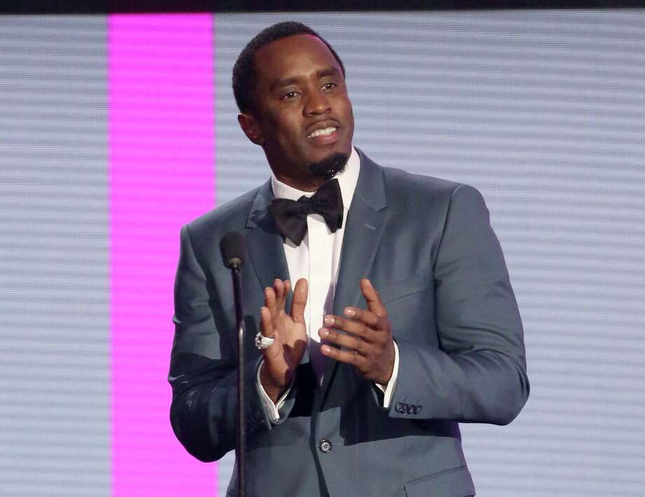 "In this Nov. 22, 2015 file photo, Sean Combs presents an award at the American Music Awards in Los Angeles. The veteran music mogul expects to perform on ""Pitbull's New Year's Resolution"" concert on Fox and will rerelease his recent critically-acclaimed mixtape ""Money Making Mitch"" through iTunes on Friday. It's the prequel to Puff Daddy's final album ""No Way Out 2,"" which will release next year. (Photo by Matt Sayles/Invision/AP, FIle) Photo: Matt Sayles / Associated Press / Invision"