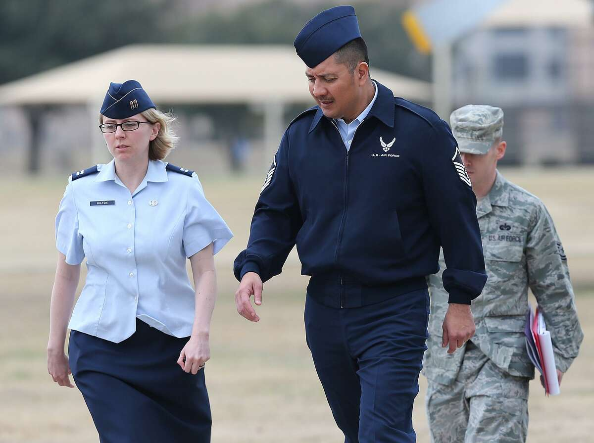 FILE - U.S. Air Force Master Sgt. Michael Silva, center, leaves an Article 32 hearing at Lackland Air Force, Monday, Feb. 24, 2013. Silva was given 20 years in the rapes of two women, but was freed after an appeals court threw out his convictions last year.