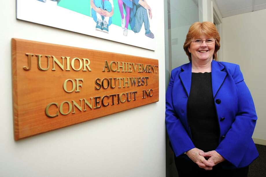 Janet Ursone, the president of Junior Achievement of Southwestern Connecticut, poses for a photo inside their Connecticut Ave. office in Norwalk, Conn. on Monday, April 16, 2018. Junior Achievement is attempting to empower young people to their own economic success by hosting classes which help teens address concerns for their financial future. Photo: Michael Cummo / Hearst Connecticut Media / Stamford Advocate