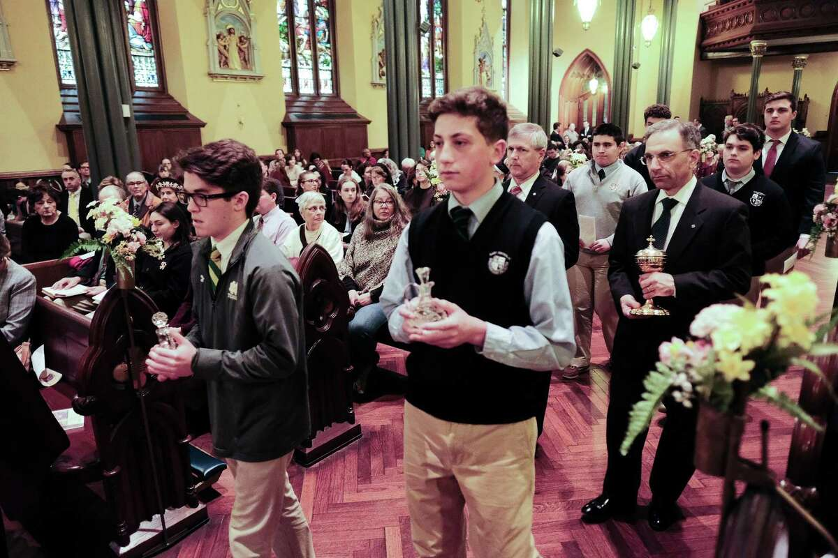 High school students from Catholic schools in the Archdiocese of Hartford participated in a special Mass for persecuted Christians in Iraq and Syria, celebrated Sunday at St. Mary Roman Catholic Church in New Haven.