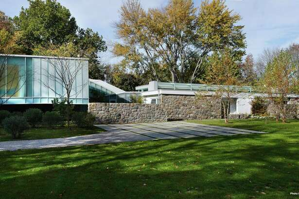 To the iconic Marcel Breuer Mid-Century Modern stone house the current owners added a glass and steel wing designed by award-winning architect Toshiko Mori.
