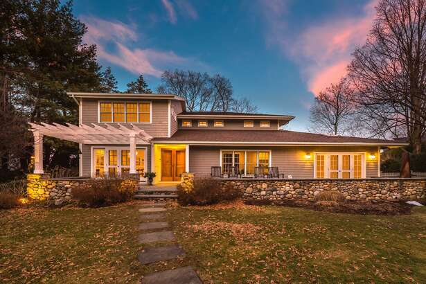 The craftsman-style colonial at 383 Old Post Road is in the Beach neighborhood, walking distance to Penfield and Jennings beaches, downtown and the train station.