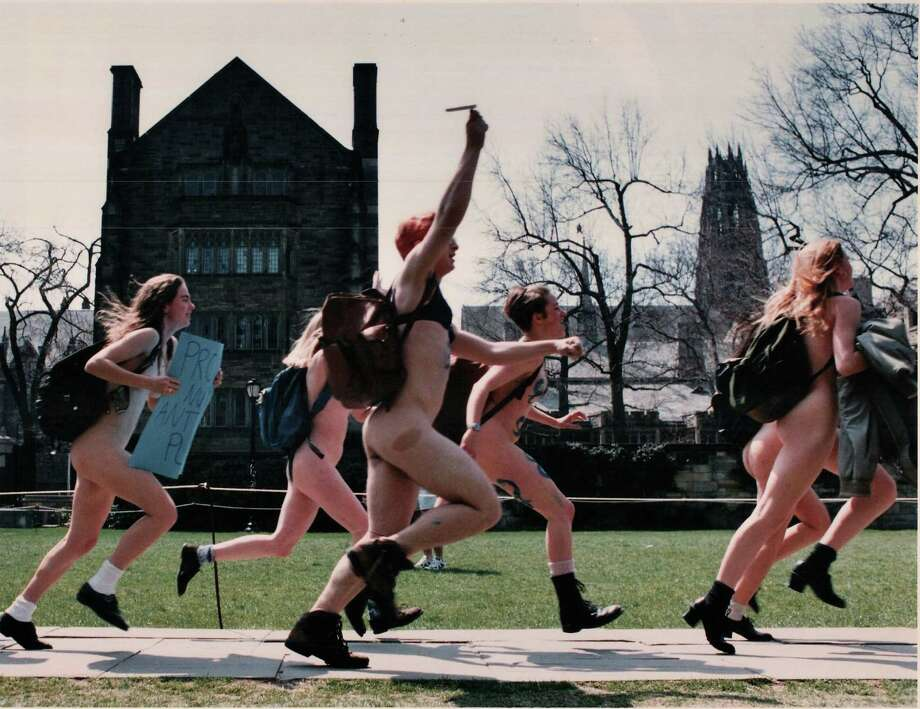 Yale students streaked across campus in 1995 in protest against the way Playboy portrays women. t reportedly was not the first time there was streaking on the Yale campus but a Register photographer caught this shot. Photo: Hearst Connecticut Media File Photo