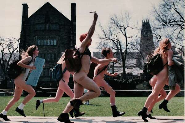 Yale students streaked across campus in 1995 in protest against the way Playboy portrays women. t reportedly was not the first time there was streaking on the Yale campus but a Register photographer caught this shot.