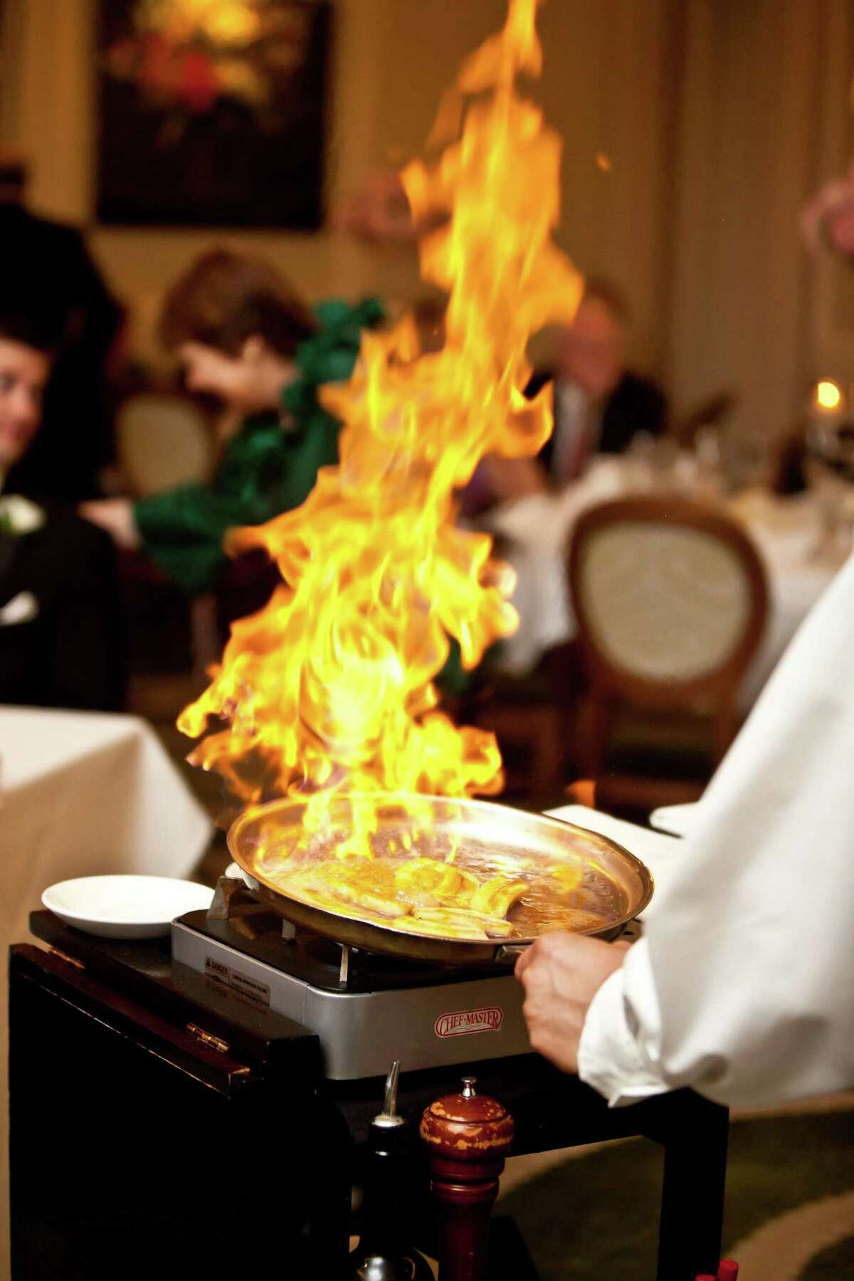 Service captain Fred Wynn Sr. prepares traditional Bananas Foster at Brennan's of Houston.