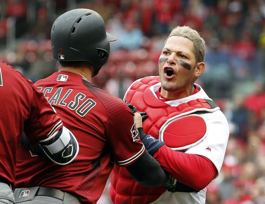 Cardinals catcher Yadier Molina is held back by Diamondbacks' Daniel Descalso. Photo: Jeff Roberson / Associated Press