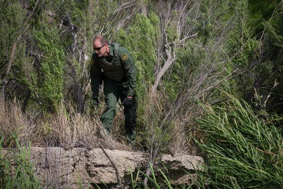 A Border Patrol agent searches the Rio Grande for undocumented immigrants crossing the border near McAllen. A reader says most such immigrants have documents — they are just illegally obtained.