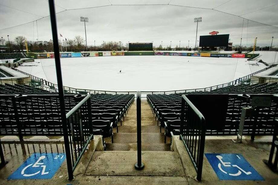 Snow covers the field at Dow Diamond on Monday afternoon. (Katy Kildee/kkildee@mdn.net)