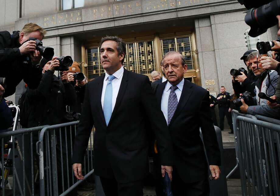 President Donald Trump's long-time personal attorney Michael Cohen (left) exits a New York court on April 16, 2018 in New York City. Trump's lawyers on Sunday night asked a federal judge to temporarily block prosecutors from reviewing files seized by the FBI from Cohen's offices and hotel room last week. Trump's lawyers have argued that many of the documents are protected by attorney-client privilege.  (Photo by Spencer Platt/Getty Images) Photo: Spencer Platt/Getty Images