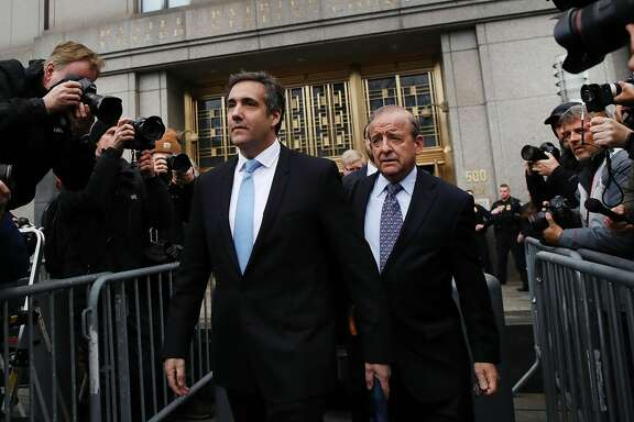 President Donald Trump's long-time personal attorney Michael Cohen (left) exits a New York court on April 16, 2018 in New York City. Trump's lawyers on Sunday night asked a federal judge to temporarily block prosecutors from reviewing files seized by the FBI from Cohen's offices and hotel room last week. Trump's lawyers have argued that many of the documents are protected by attorney-client privilege.  (Photo by Spencer Platt/Getty Images)