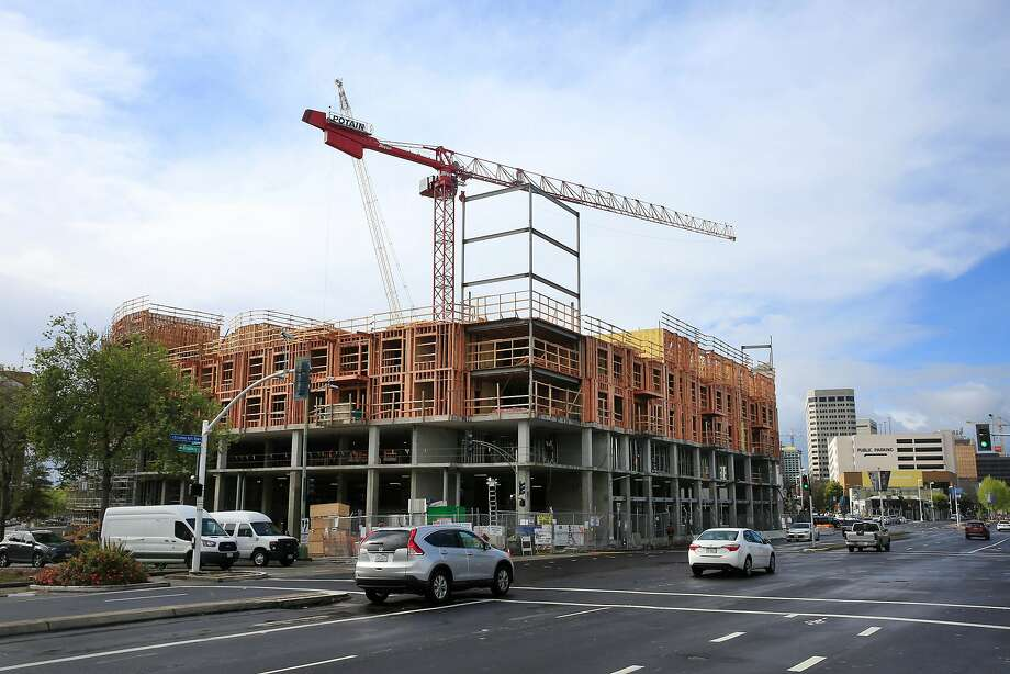 New construction is seen at Broadway and 27th Avenue in Oakland. A bill by Sen. Scott Wiener, D-S.F., would hobble local control of such projects. Photo: Lea Suzuki / The Chronicle