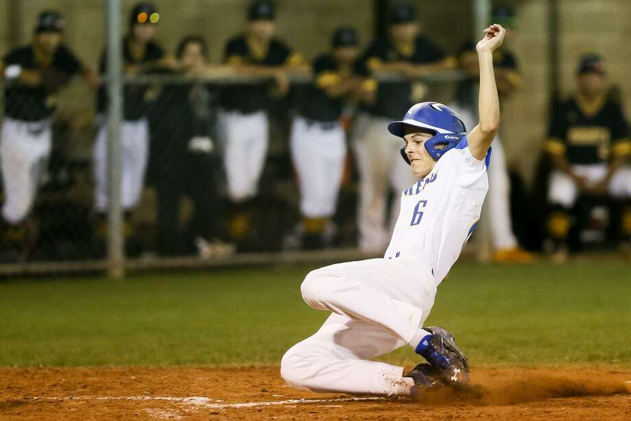 Clemens' Ryan Ward slides into home plate on a passed ball to the catcher with the bases loaded during the seventh inning to win their District 27-6A baseball game with East Central. Photo: Marvin Pfeiffer / San Antonio Express-News / Express-News 2018