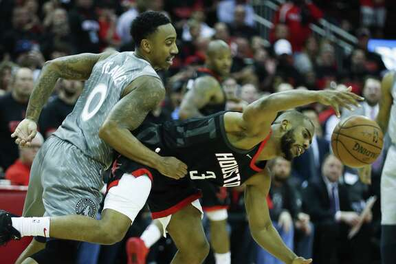 Minnesota Timberwolves guard Jeff Teague (0) fouls Houston Rockets guard Chris Paul (3) during the fourth quarter of Game 1 of an NBA basketball first-round playoff series at Toyota Center on Sunday, April 15, 2018, in Houston. ( Brett Coomer / Houston Chronicle )
