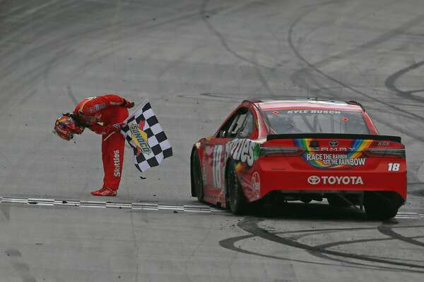 BRISTOL, TN - APRIL 16:  Kyle Busch, driver of the #18 Skittles Toyota, celebrates with the checkered flag after winning the rain delayed  Monster Energy NASCAR Cup Series Food City 500 at Bristol Motor Speedway on April 16, 2018 in Bristol, Tennessee.  (Photo by Sean Gardner/Getty Images)