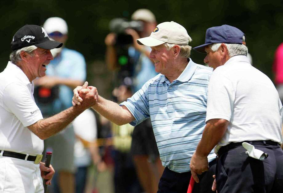 "Jack Nicklaus, center, celebrates with Gary Player, left, as Lee Trevino looks on after making a putt on the first green during the ""Greats of Golf"" section of the Insperity Invitational Saturday. Photo: Jason Fochtman / Internal"
