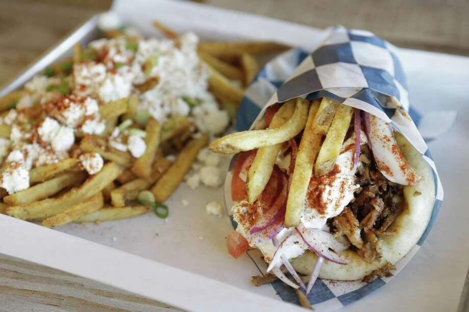 Pork gyro with GRK fries at Just GRK Photo: Melissa Phillip, Staff / Houston Chronicle / © 2018 Houston Chronicle