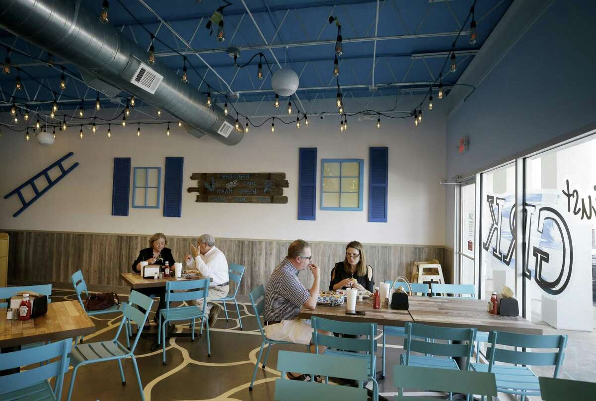 The dining room at Just GRK, a Greek grill restaurant in west Houston.