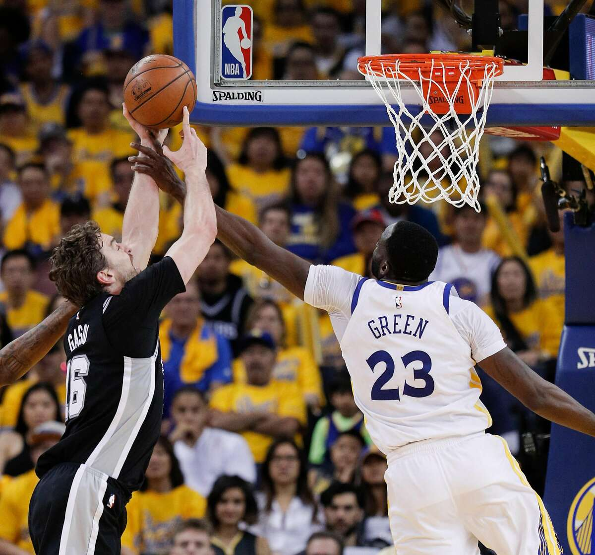 Golden State Warriors' Draymond Green fouls San Antonio Spurs' Pau Gasol in the fourth quarter during game 1 of round 1 of the Western Conference Finals at Oracle Arena on Saturday, April 14, 2018 in Oakland, Calif.