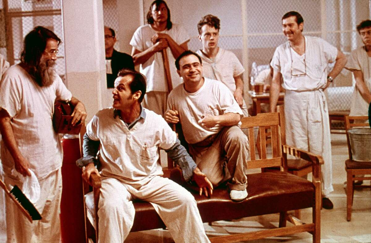 1975: American actor Jack Nicholson and others share a laugh in a still from the film, 'One Flew Over the Cuckoo's Nest,' directed by Milos Forman. (Photo by Republic Pictures/Republic Pictures/Getty Images)