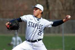 Jack Portman pitches for Staples against Xavier on April 7. Staples is one of four remaining unbeaten teams in Class LL.