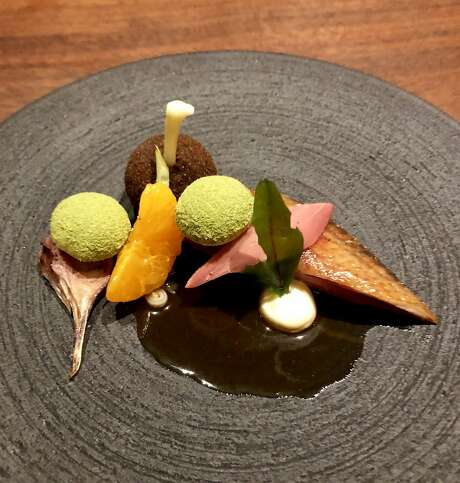 Pigeon with ramps, mandarin and pommes soufflees. Photo: Michael Bauer / The Chronicle