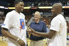 Former UConn players Rudy Gay, left, and Ray Allen, right, talk with their former coach Jim Calhoun prior to the 2010 Jim Calhoun Celebrity Classic Charity All-Star basketball game in Uncasville.