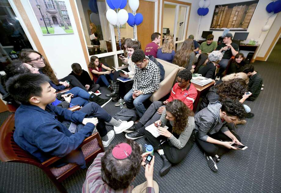Yale University students occupy the waiting area of the Yale University Financial Aid office in New Haven Monday. Photo: Arnold Gold / Hearst Connecticut Media / New Haven Register