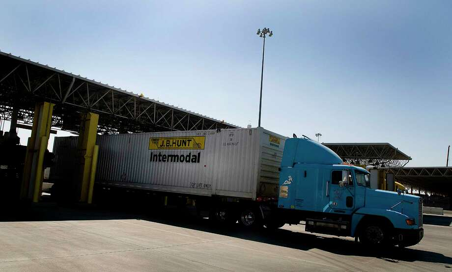 A truck carrying a J.B. Hunt Transport Services Inc. intermodal container from Mexico enters a U.S. Customs and Border Protection (CBP) inspection station at the Otay Mesa Port of Entry in Sand Diego, California, U.S., on Monday, March 12, 2012. Mexican exports, which account for about 30 percent of the country's gross domestic product, soared 17 percent last year to $350 billion. Photographer: Sam Hodgson/Bloomberg Photo: Sam Hodgson / © 2012 Bloomberg Finance LP