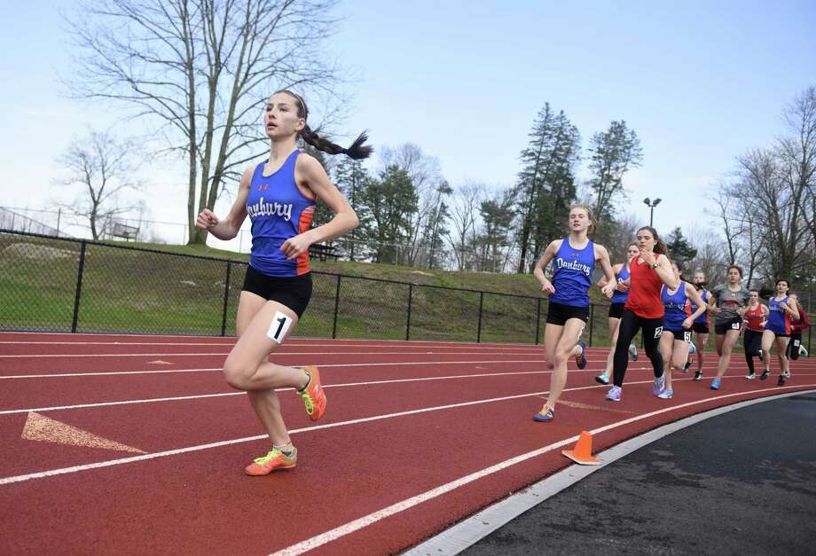 Danbury's Lauren Moore leads the pack in the 1600 meter run in the high school girls track and field meet between Greenwich, Danbury and Central Bridgeport at Greenwich High School in Greenwich, Conn. Monday, April 16, 2018. Photo: Tyler Sizemore / Hearst Connecticut Media / Greenwich Time