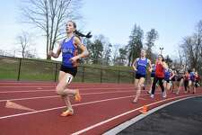 Danbury's Lauren Moore leads the pack in the 1600 meter run in the high school girls track and field meet between Greenwich, Danbury and Central Bridgeport at Greenwich High School in Greenwich, Conn. Monday, April 16, 2018.