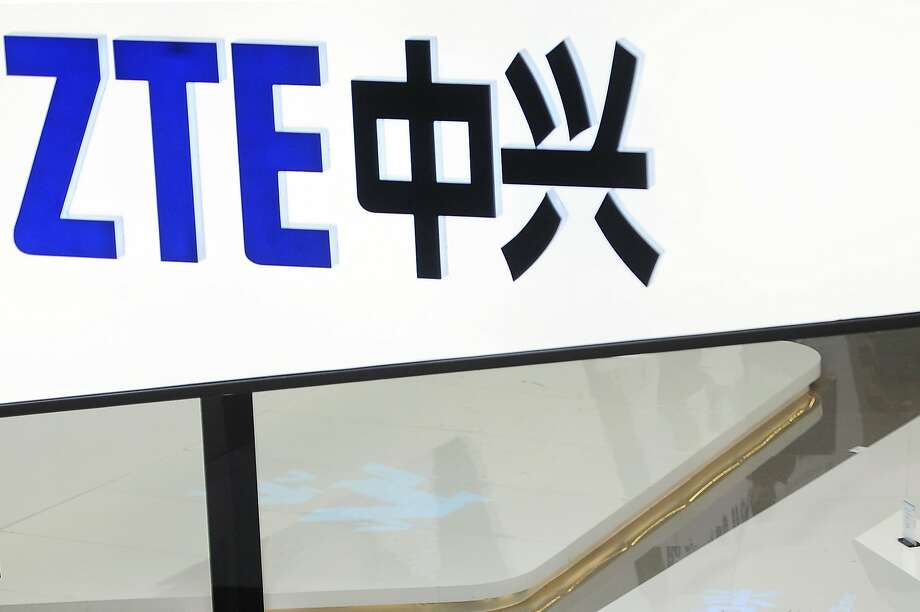 FILE- In this Feb. 26, 2014, file photo, a sign for the ZTE booth is seen at the Mobile World Congress, the world's largest mobile phone trade show in Barcelona, Spain.  The U.S. Commerce Department is blocking Chinese telecommunications giant ZTE Corp. from importing American components for seven years, accusing the company of misleading U.S. regulators after it settled charges of violating sanctions against North Korea and Iran. (AP Photo/Manu Fernandez, File) Photo: Manu Fernandez, Associated Press