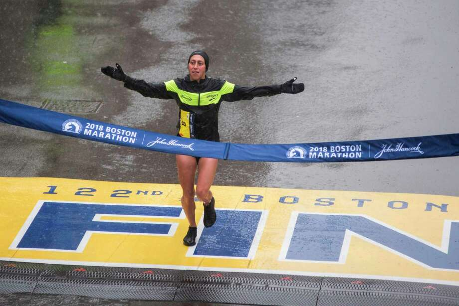 Desiree Linden of the United States crosses the finish line as the winner of the 2018 and 122nd Boston Marathon for Elite Women's race with a time of 2:39:54 on April 16, 2018 in Boston, Massachusetts.  Her personal best finish was previously second place in the Boston Marathon in 2011 with a time of 2:22:38. / AFP PHOTO / RYAN MCBRIDERYAN MCBRIDE/AFP/Getty Images Photo: RYAN MCBRIDE / AFP or licensors