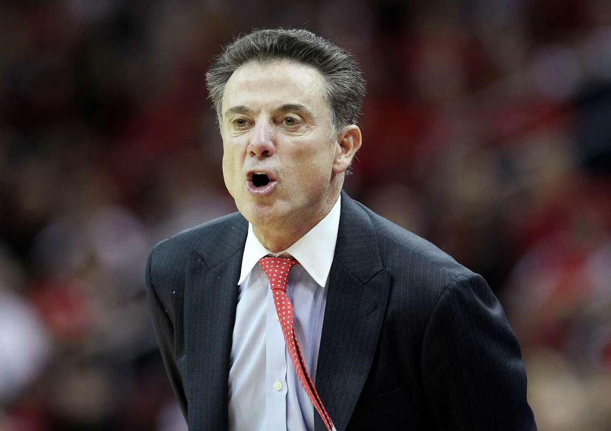 A friend to Rick Pitino, shown coaching the Louisville Cardinals, says he'd be interested coming to Siena College. But would he be a good fit for the Catholic school in Loudonville? (Photo by Dylan Buell/Getty Images)