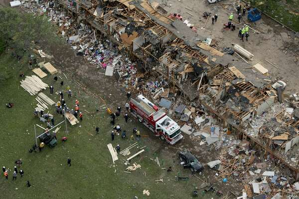 WEST, TX - APRIL 18:  Search and rescue workers comb through what remains of a 50-unit apartment building the day after an explosion at the West Fertilizer Company destroyed the building April 18, 2013 in West, Texas. According to West Mayor Tommy Muska, around 14 people, including 10 first responders, were killed and more than 150 people were injured when the fertilizer company caught fire and exploded, leaving damaged buildings for blocks in every direction.  (Photo by Chip Somodevilla/Getty Images)