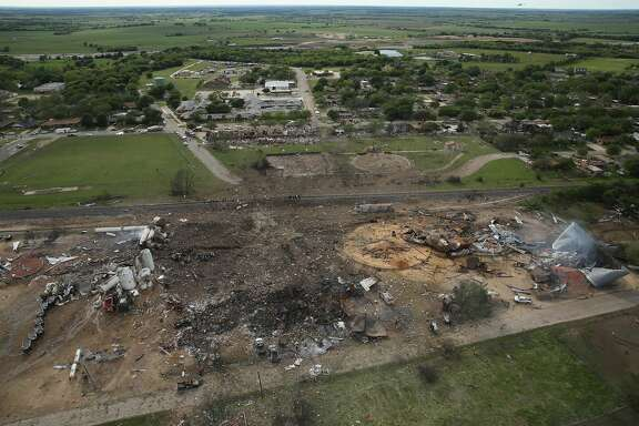 WEST, TX - APRIL 18:  The West Fertilizer Company, shown from the air, lies in ruins on April 18, 2013 in West, Texas. According to West Mayor Tommy Muska, around 14 people, including 10 first responders, were killed and more than 150 people were injured when the fertilizer company caught fire and exploded yesterday, leaving damaged buildings for blocks in every direction.  (Photo by Chip Somodevilla/Getty Images)