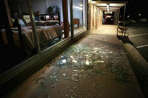WEST, TX - APRIL 18:  Blown out plate glass windows lay shattered on the sidewalk and street after the West Fertilizer Company exploded on April 18, 2013 in West, Texas. A massive explosion at the fertilizer company injured more than 100 people and left damaged buildings for blocks in every direction. The death toll from the blast, which occured as firefighters were tackling a blaze, is as yet unknown. (Photo by Chip Somodevilla/Getty Images)