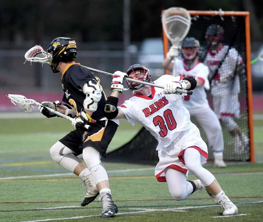 Hand's Jack Flanagan, left, is defendied by Cheshire's Ethan Bronson on Monday. Photo: Arnold Gold / Hearst Connecticut Media / New Haven Register