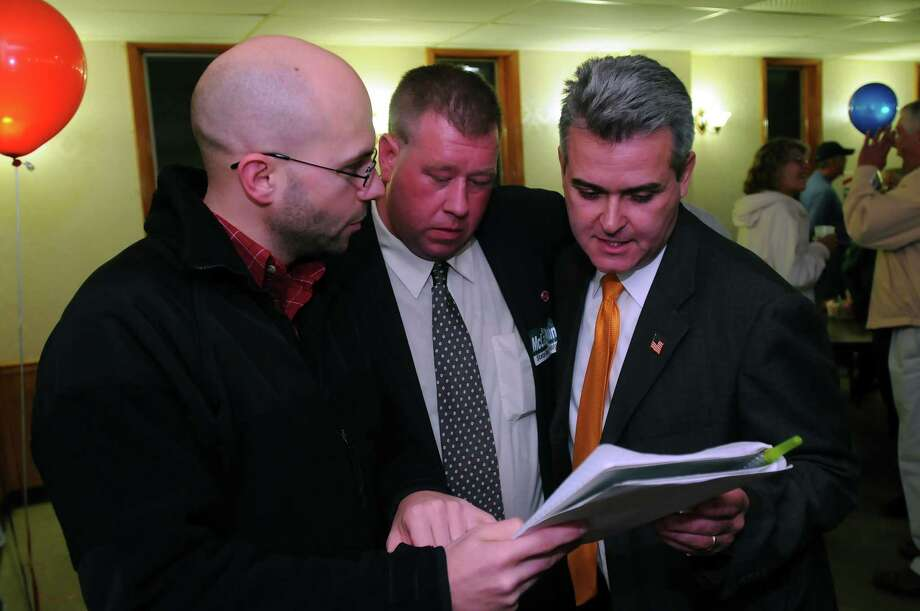 "Steve McLaughlin, Republican candidate for the 108th Assembly District, checks voting results with Jeremy Near, left, and Chris Tague, center,   in Troy, NY on Tuesday November 2, 2010.  ""Two years ago (he said he told his wife), we laid the foundation to build the house, and tonight we got the certificate of occupancy,"" McLaughlin said in his victory speech. ( Philip Kamrass / Times Union ) Photo: Philip Kamrass / 00010906A"