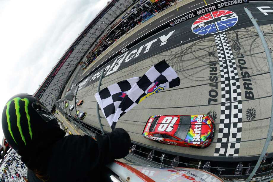 BRISTOL, TN - APRIL 16: Kyle Busch, driver of the #18 Skittles Toyota, takes the checkered flag to win the rain delayed  Monster Energy NASCAR Cup Series Food City 500 at Bristol Motor Speedway on April 16, 2018 in Bristol, Tennessee.  (Photo by Robert Laberge/Getty Images) Photo: Robert Laberge / 2018 Getty Images