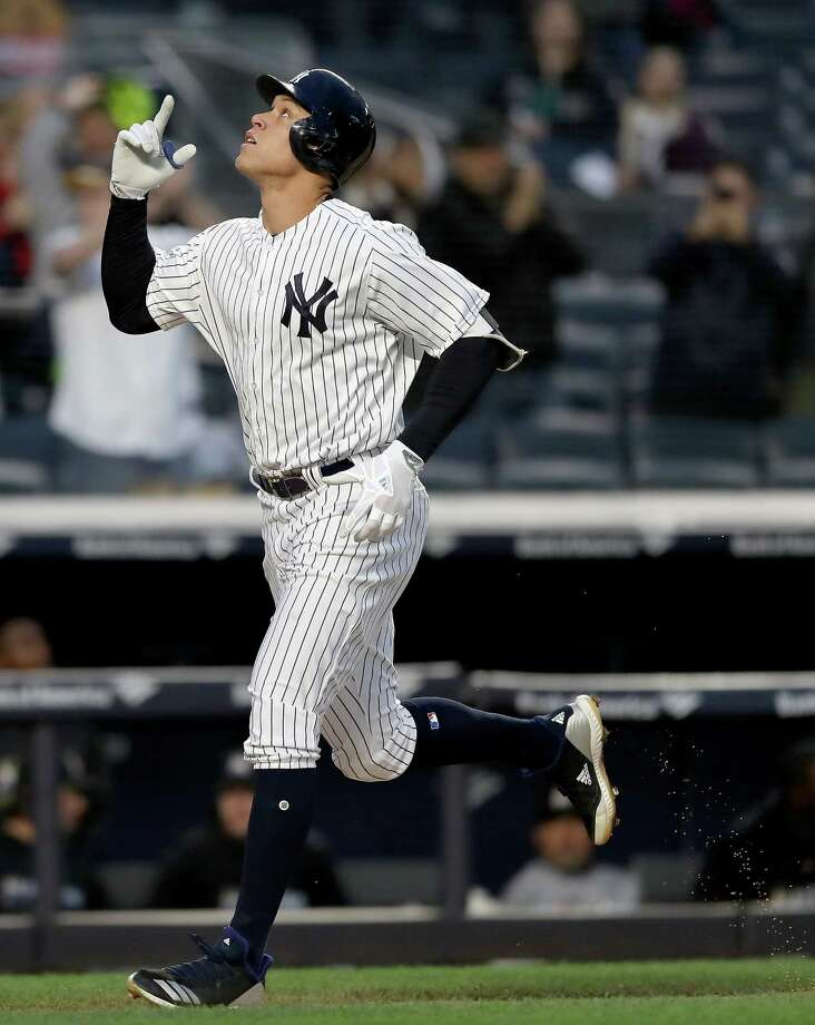 NEW YORK, NY - APRIL 16:  Aaron Judge #99 of the New York Yankees celebrates his solo home run in the second inning against the Miami Marlins at Yankee Stadium on April 16, 2018 in the Bronx borough of New York City.  (Photo by Elsa/Getty Images) Photo: Elsa / 2018 Getty Images