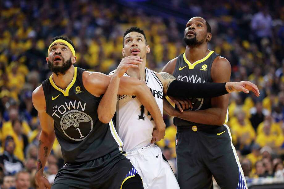 Golden State Warriors' JaVale McGee and Kevin Durant fight for position against San Antonio Spurs' Danny Green in the first quarter during game 2 of round 1 of the Western Conference Finals at Oracle Arena on Monday, April 16, 2018 in Oakland, Calif. Photo: Scott Strazzante, The Chronicle / online_yes