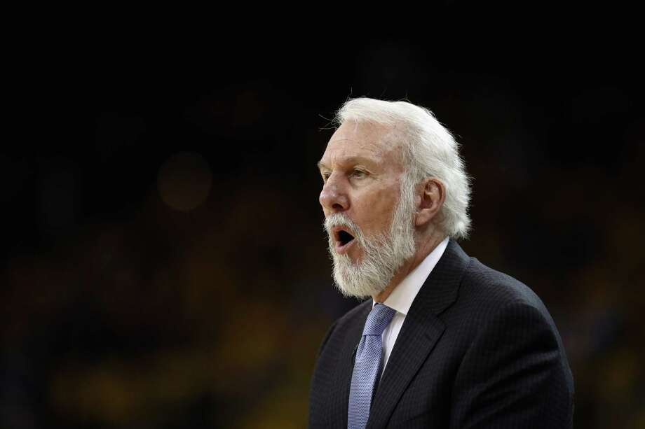 Head coach Gregg Popovich of the San Antonio Spurs shouts to his team during their game against the Golden State Warriors in Game 2 of Round 1 of the 2018 NBA Playoffs at ORACLE Arena on April 16, 2018 in Oakland, California. NOTE TO USER: User expressly acknowledges and agrees that, by downloading and or using this photograph, User is consenting to the terms and conditions of the Getty Images License Agreement. Photo: Ezra Shaw, Getty Images / 2018 Getty Images