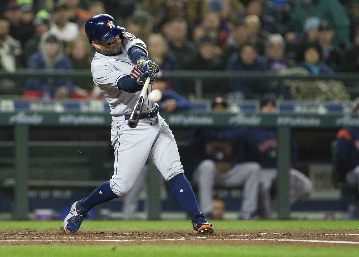 SEATTLE, WA - APRIL 16: Jose Altuve #27 of the Houston Astros hits a long ball to right field in the third inning but its caught by Mitch Haniger #17 of the Seattle Mariners at Safeco Field on April 16, 2018 in Seattle, Washington.