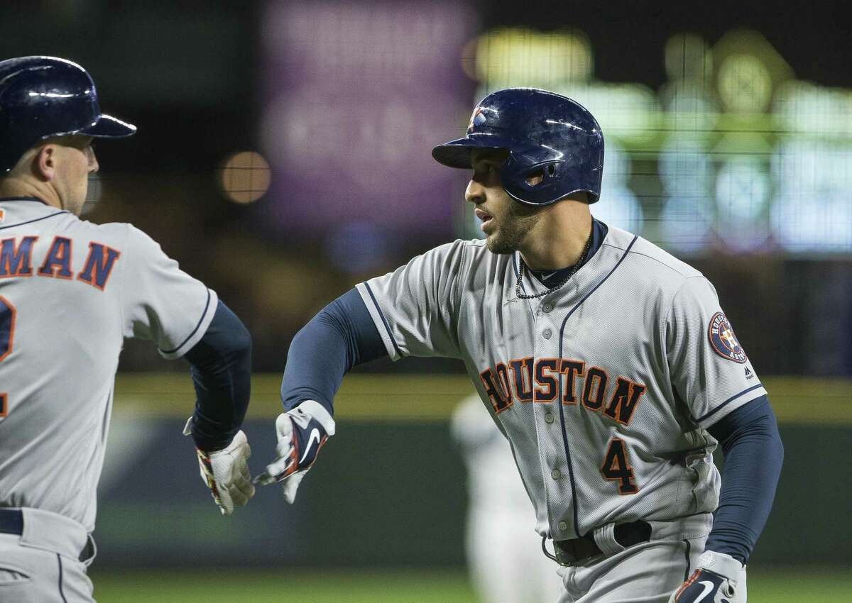 SEATTLE, WA - APRIL 16: George Springer #4 of the Houston Astros, right, is greeted by Alex Bregman #2 after hitting a home run in the first inning against the Seattle Mariners at Safeco Field on April 16, 2018 in Seattle, Washington.