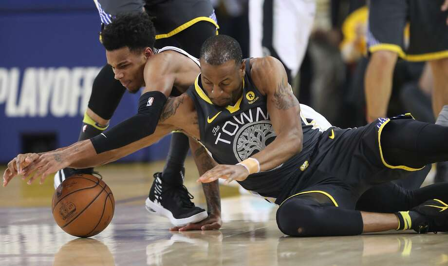 Golden State Warriors' Andre Iguodala fights San Antonio Spurs' Dejounte Murray for a loose ball in the first quarter during game 2 of round 1 of the Western Conference Finals at Oracle Arena on Monday, April 16, 2018 in Oakland, Calif. Photo: Scott Strazzante / The Chronicle