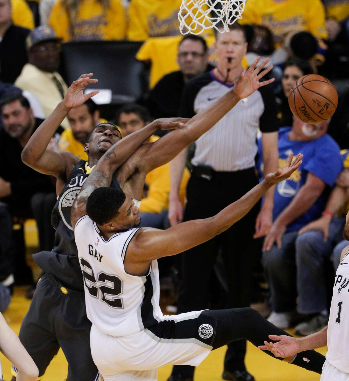 Golden State Warriors' Kevon Looney and San Antonio Spurs' Rudy Gay fight for a rebound in the second quarter during game 2 of round 1 of the Western Conference Finals at Oracle Arena on Monday, April 16, 2018 in Oakland, Calif.