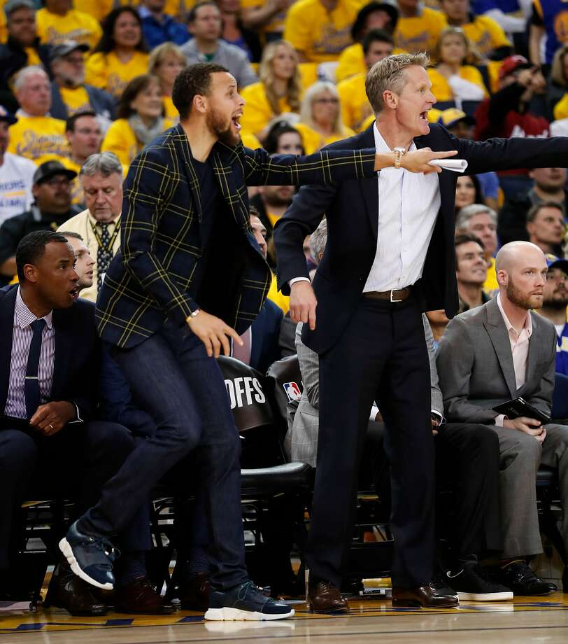 Golden State Warriors' Stephen Curry and head coach Steve Kerr react in the fourth quarter during game 2 of round 1 of the Western Conference Finals at Oracle Arena on Monday, April 16, 2018 in Oakland, Calif. Photo: Scott Strazzante, The Chronicle