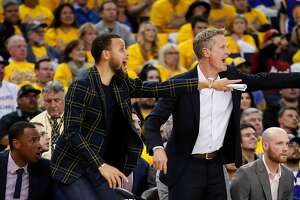 Golden State Warriors' Stephen Curry and head coach Steve Kerr react in the fourth quarter during game 2 of round 1 of the Western Conference Finals at Oracle Arena on Monday, April 16, 2018 in Oakland, Calif.