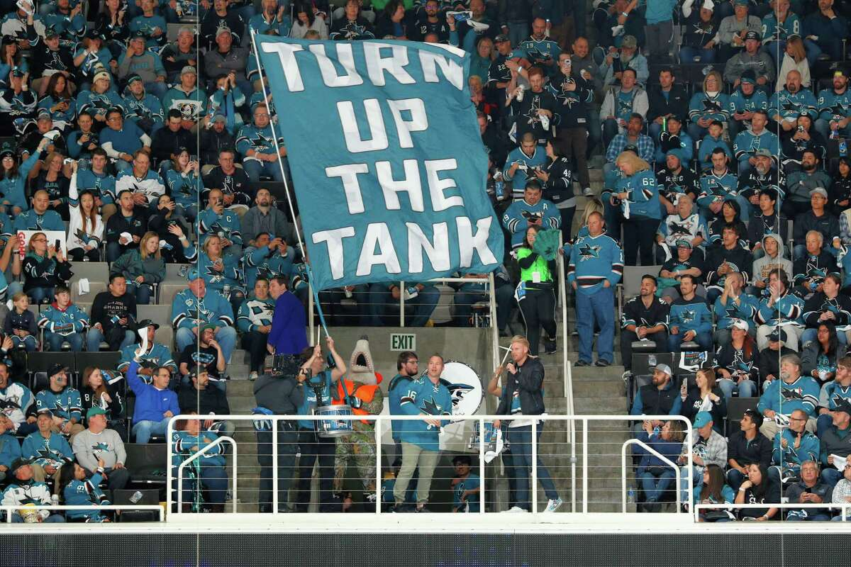 """S.J. Sharkie, San Jose's team mascot, and Sharks fans """"Turn Up The Tank"""" in Game 3 at the Shark Tank in San Jose."""